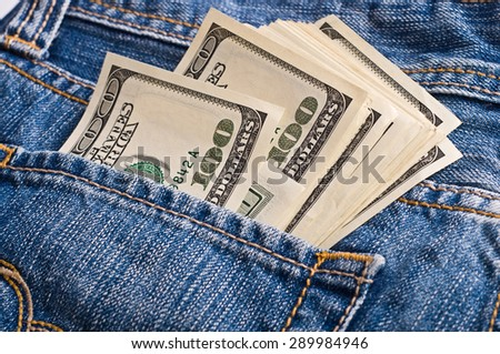 American Dollars in the pocket of jeans - stock photo