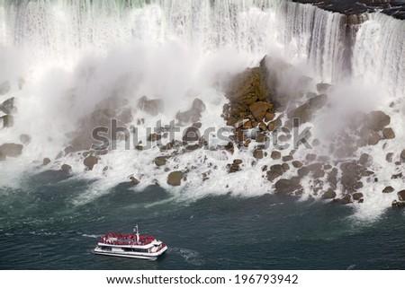 American Falls and cruise boat, Niagara, Canada - stock photo