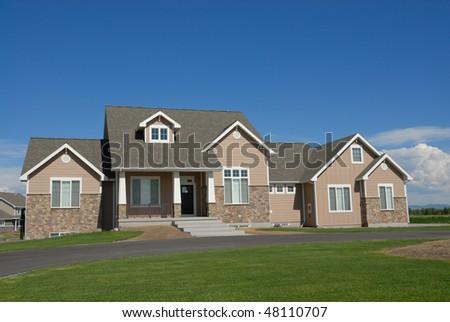 Brick ranch stone accents stock photo 5429692 shutterstock for Brick homes with stone accents
