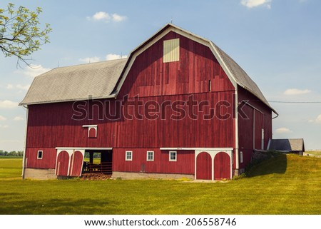 American Farmland With Blue Cloudy Sky  - stock photo