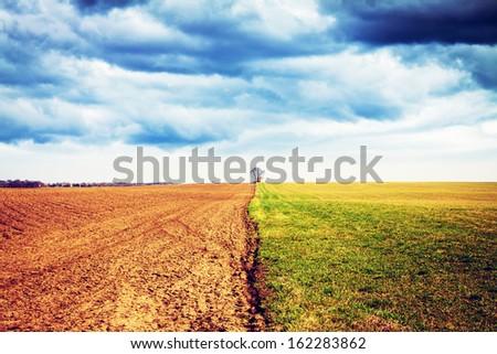American Farmland with stormy sky - stock photo