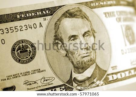 American five dollar banknote - stock photo