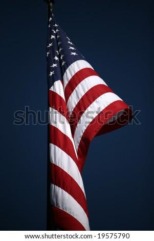 american flag against a blue sky - stock photo