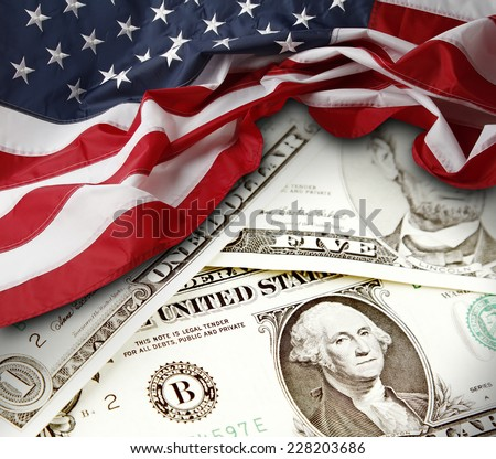 American flag and banknotes - stock photo