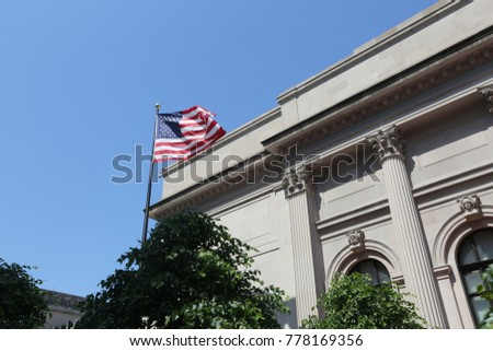 American flag and white building in New York