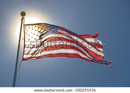 American flag back lit by sun - stock photo