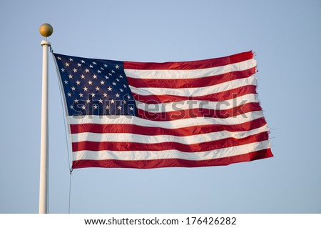 American flag blows in the wind by the ocean in Newport, Rhode Island - stock photo