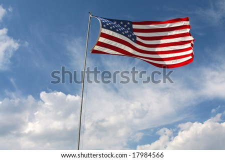 American Flag flowing in the blue sky - stock photo