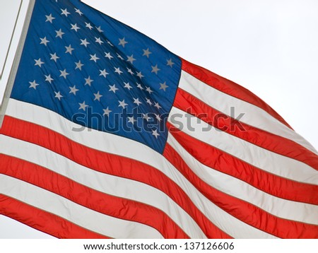 American Flag Flying Proudly in the Wind