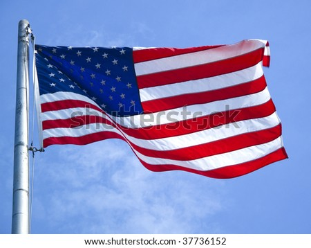 American flag on a flagpole blowing in the wind