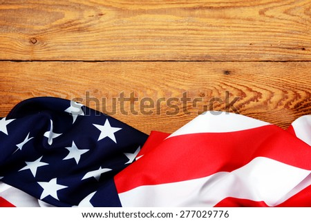 American flag on a wooden background - stock photo