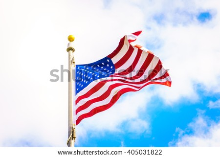 American flag on blue sky - stock photo