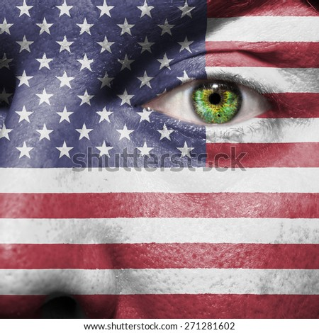 American flag painted on a mans face to support his country the United States of America