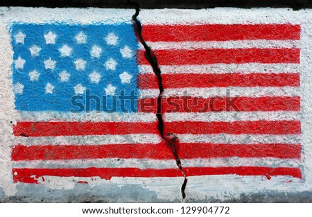 American flag painted on a wall cracked in the middle