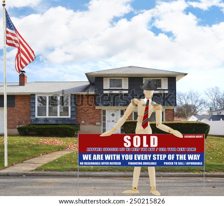American flag pole Real estate sold (another success let us help you buy sell your next home) sign Suburban high ranch brick home autumn blue sky clouds day residential neighborhood USA - stock photo