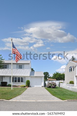 American Flag Pole Rhododendrons Blooming Suburban House Front Residential Neighborhood Street Blue Sky Clouds USA