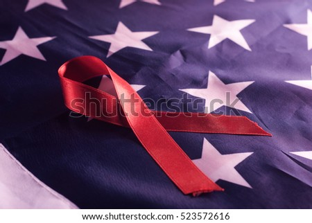 American flag, red ribbon, AIDS, symbols, stars