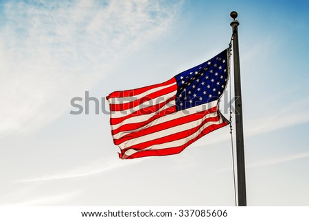 American flag star and stripes on the blue sky