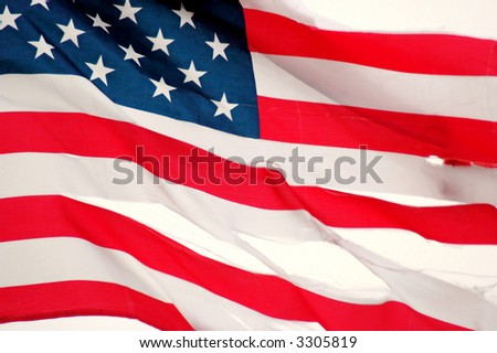 American Flag Torn flapping in the wind - stock photo