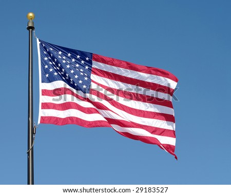 American flag waving against blue sky. See similar in my portfolio.