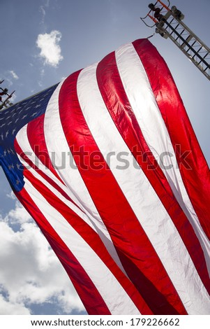 American flag waving over fire truck - stock photo