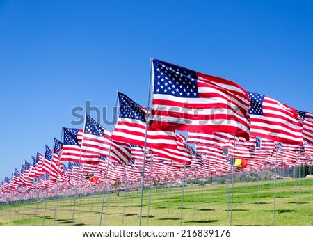 American flags background on a green field  - stock photo