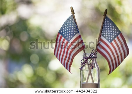American flags with bokeh green background. July 4th celebration. - stock photo