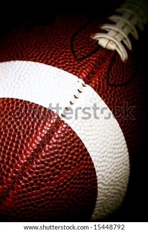 american football against a black background - stock photo