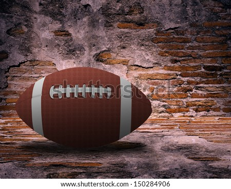 American football and old brick wall as background - stock photo