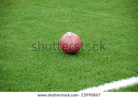 American football ball on field - stock photo