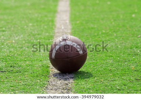 American football ball. Shallow focus on the ball. - stock photo