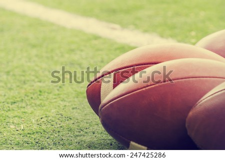 American football balls. - stock photo