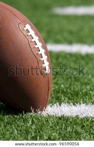 American Football Close up on Field with room for copy - stock photo