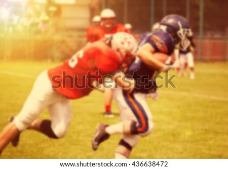 American football game - out of focus background of the field in the sunset - stock photo