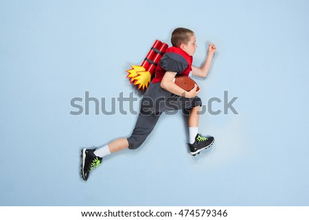 American Football kid with rocket booster backpack