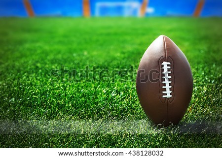 American football on field near yard line - stock photo