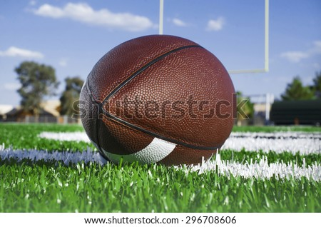 American football on find with goal posts - stock photo