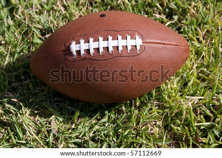 American Football on real grass field - stock photo