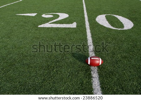 American football on the field near the Twenty - stock photo