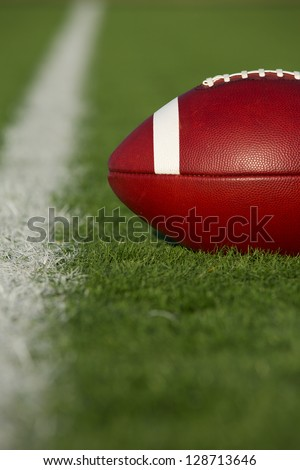 American Football on the Field near the Yard Line - stock photo