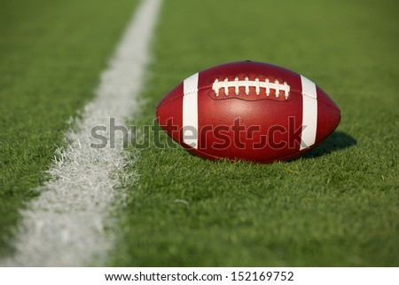 American Football on the Field with room for copy - stock photo