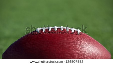 American Football on the Field with Room for Copy Above - stock photo