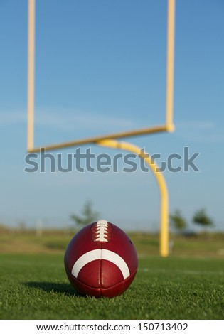 American Football on the Field with the Uprights Beyond - stock photo
