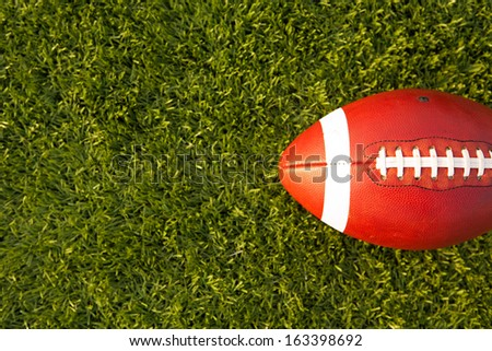 American Football on the Turf Field with room for copy - stock photo