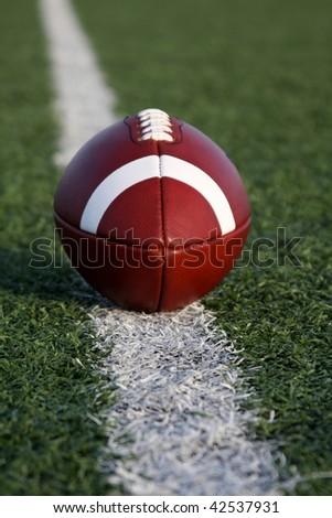 American Football on the Yard Line - stock photo