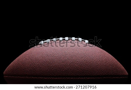 American football over black background - stock photo