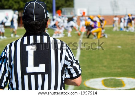 American Football played by young men with game official linesman referee