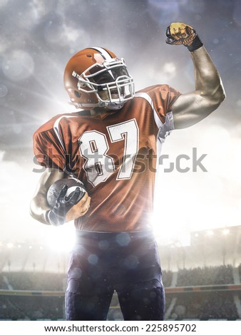 American football player in action on stadium - stock photo
