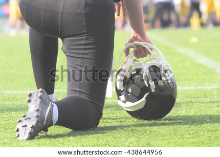 American football player preparing to join the game. - stock photo