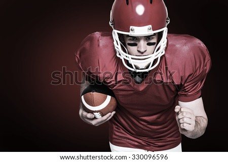 American football player running with the ball against red background with vignette